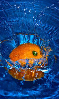 240x400 Wallpaper orange, spray, water, fruit, citrus