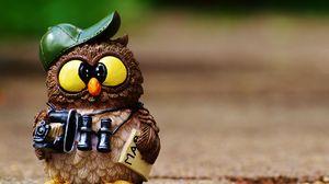 Preview wallpaper owl, figurine, cap, binoculars