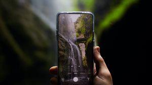 Preview wallpaper phone, camera, hand, waterfall