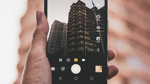 Preview wallpaper phone, hand, building, photo