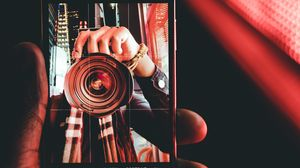 Preview wallpaper phone, hand, photo, focus, blur, bokeh