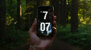 Preview wallpaper phone, hand, time, forest, trees