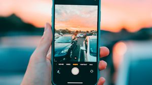 Preview wallpaper phone, smartphone, hand, cars, photo