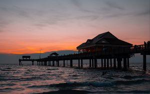 Preview wallpaper pier, building, sea, dusk