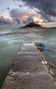 Preview wallpaper pier, sea, island, clouds, landscape