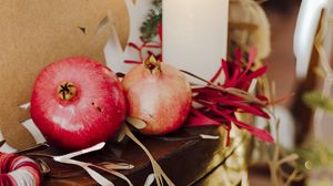 Preview wallpaper pomegranate, fruit, candles, garland, christmas, aesthetics