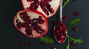 Preview wallpaper pomegranate, fruit, red, spoon, leaves