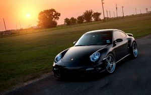 Preview wallpaper porsche, 911, turbo, 997, black, front, sun, grass, reflections