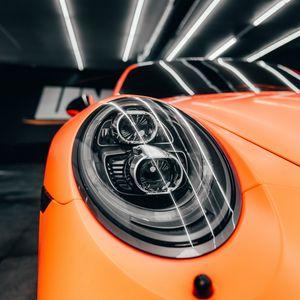 Preview wallpaper porsche, car, orange, headlight, front view