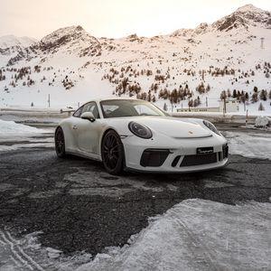 Preview wallpaper porsche, car, sports car, white, snow, mountains