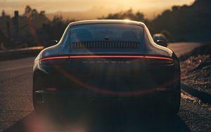 Preview wallpaper porsche, sports car, rear view, black, sunlight, movement