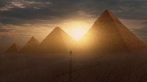 Preview wallpaper pyramids, sun, desert, silhouette, sunset