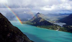 Preview wallpaper rainbow, ocean, mountains, land, relief, landscape, sky, clouds, river, coast