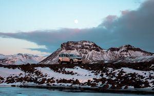 Preview wallpaper renault, car, rocks, snow, river
