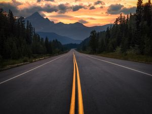 Preview wallpaper road, asphalt, marking, mountains, trees, turn, jasper, canada