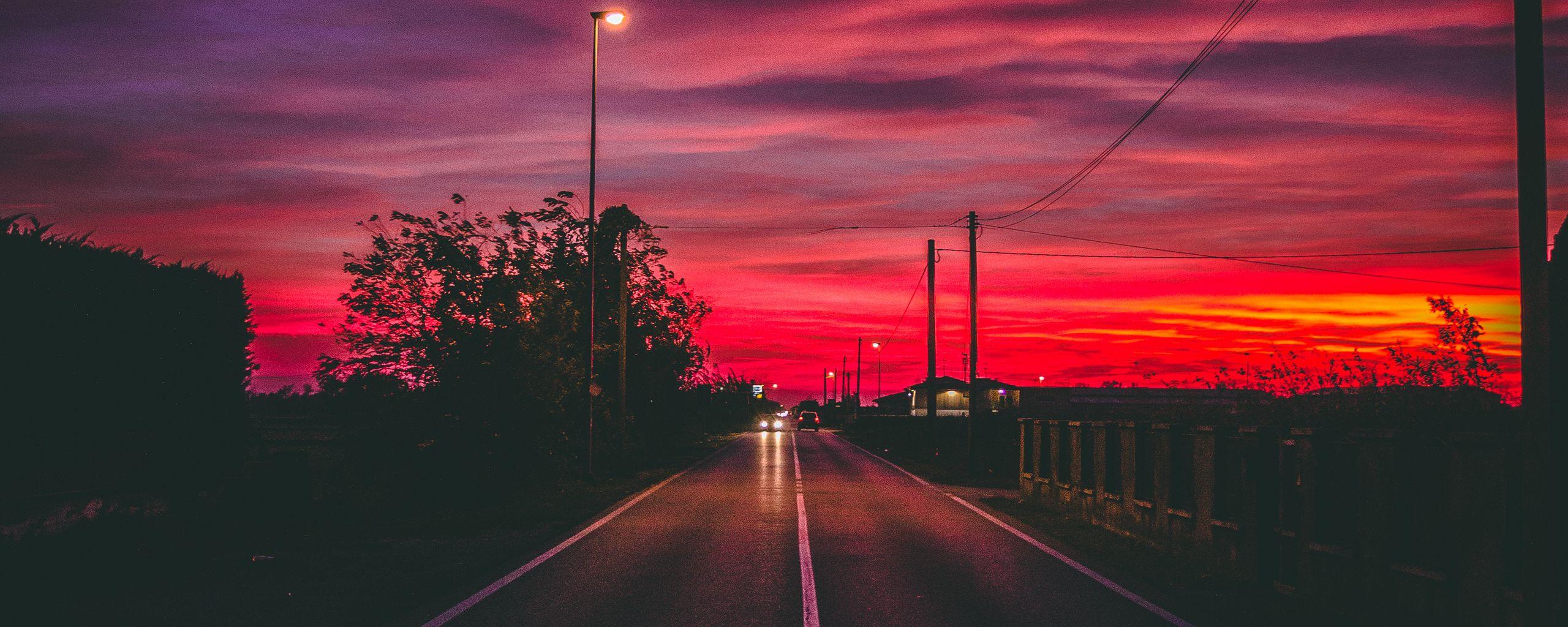 2560x1024 Wallpaper road, sunset, horizon, marking