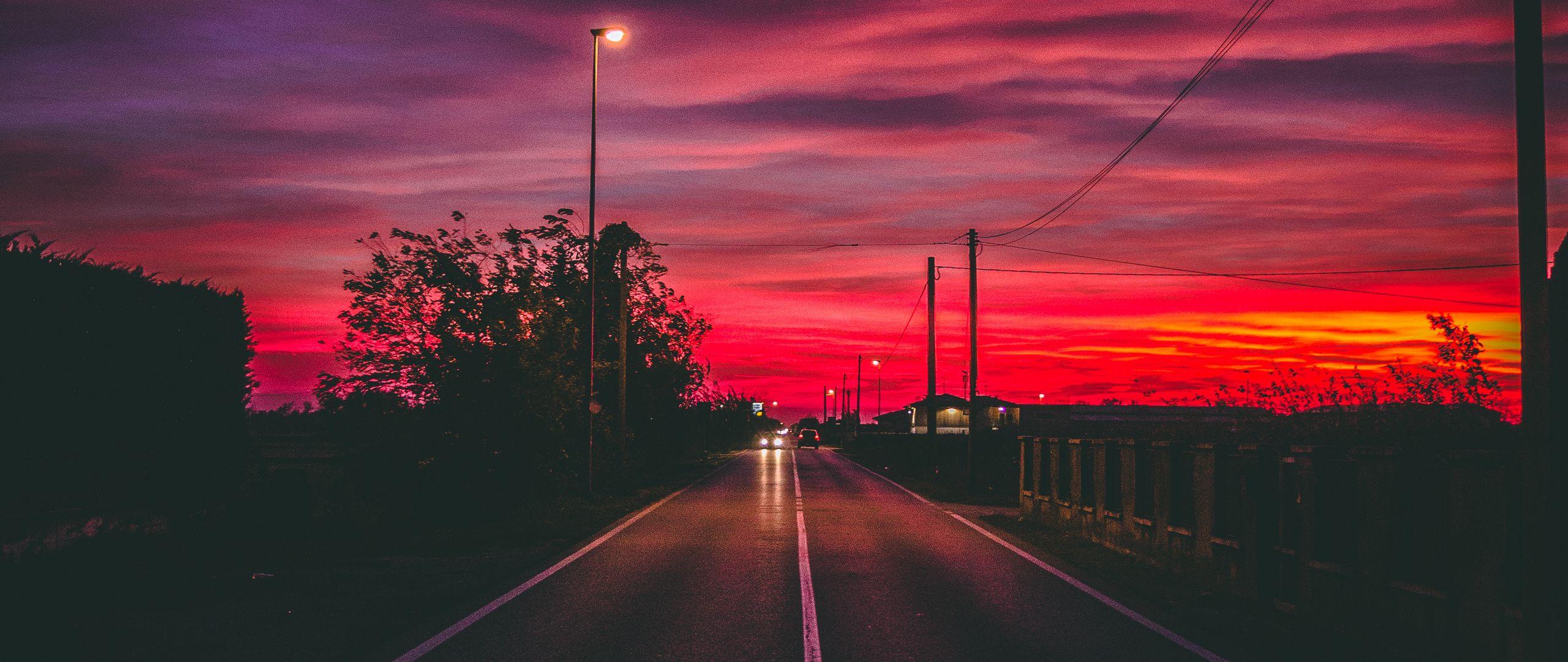 2560x1080 Wallpaper road, sunset, horizon, marking