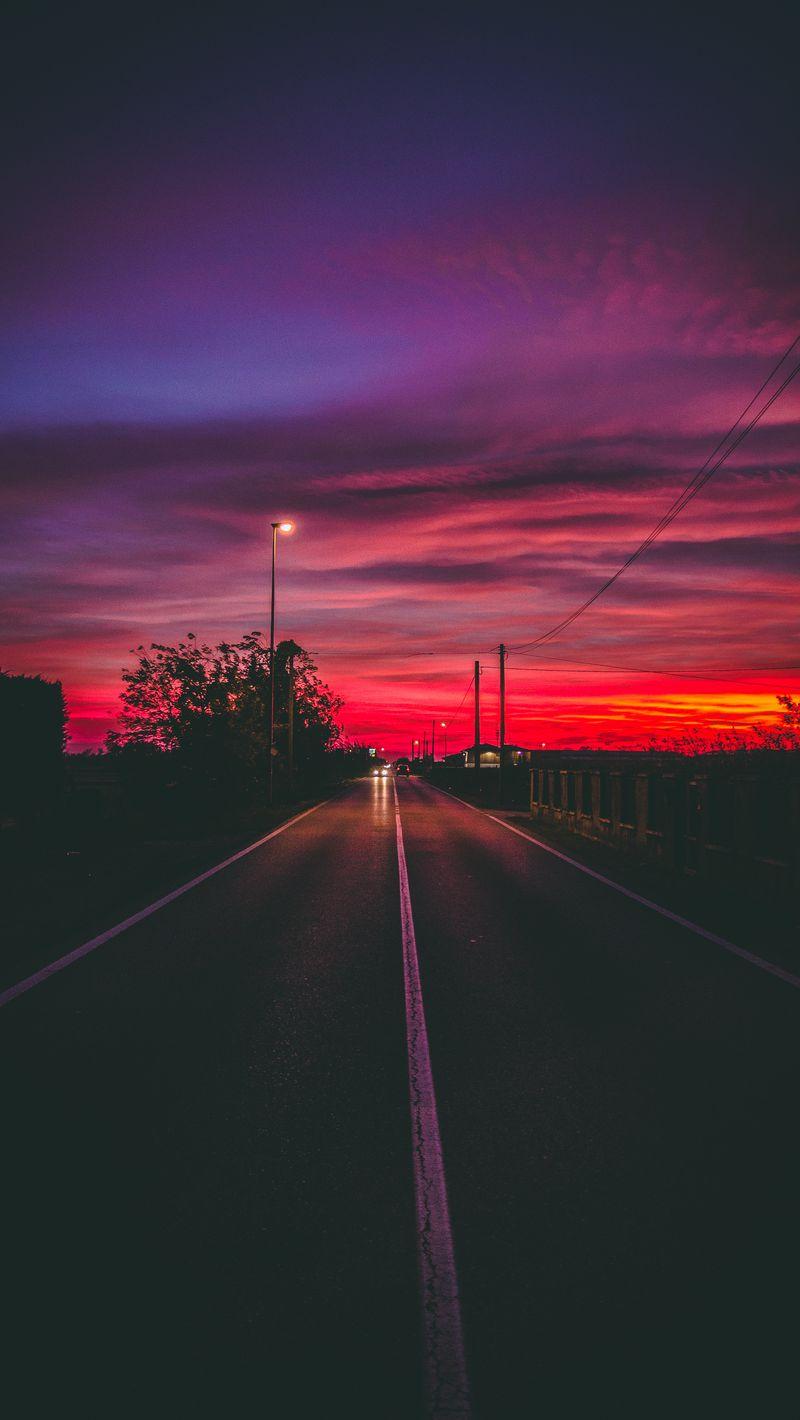 800x1420 Wallpaper road, sunset, horizon, marking