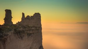 Preview wallpaper rock, cliff, fog, mountain, height, stone