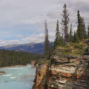 Preview wallpaper rock, cliff, trees, river, landscape, nature