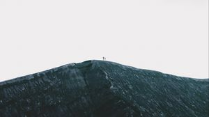 Preview wallpaper rock, mountain, silhouettes, top, sky, minimalism