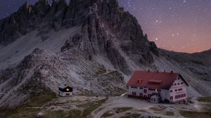 Preview wallpaper rocks, mountains, starry sky, house, night
