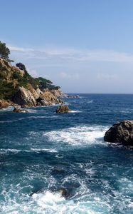 Preview wallpaper rocks, sea, coast, stones, cuts, dark blue, trees, foam, horizon, force
