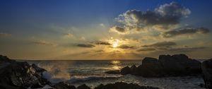 Preview wallpaper rocks, sea, sun, sunset, landscape, dark