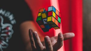 Preview wallpaper rubiks cube, hand, levitation, colorful