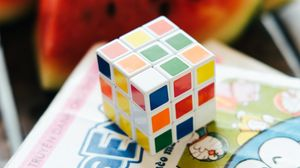 Preview wallpaper rubiks cube, puzzle, book, light