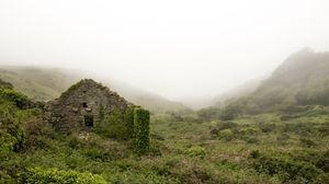 Preview wallpaper ruins, mountains, grass, fog