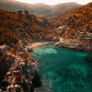 Preview wallpaper sea, rocks, aerial view, coast, beach, bay