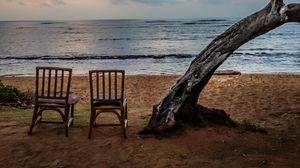 Preview wallpaper sea, shore, chairs, view, twilight, landscape