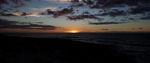 Preview wallpaper sea, sunset, clouds, landscape, dark