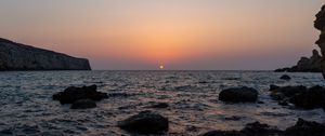 Preview wallpaper sea, water, stones, sun, sunset