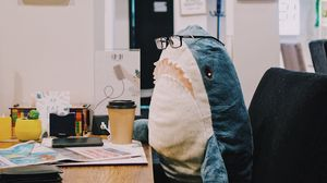 Preview wallpaper shark, toy, humor, work, office
