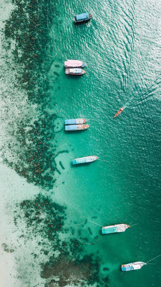540x960 Wallpaper shore, boats, sandbar, ocean, moored, aerial view