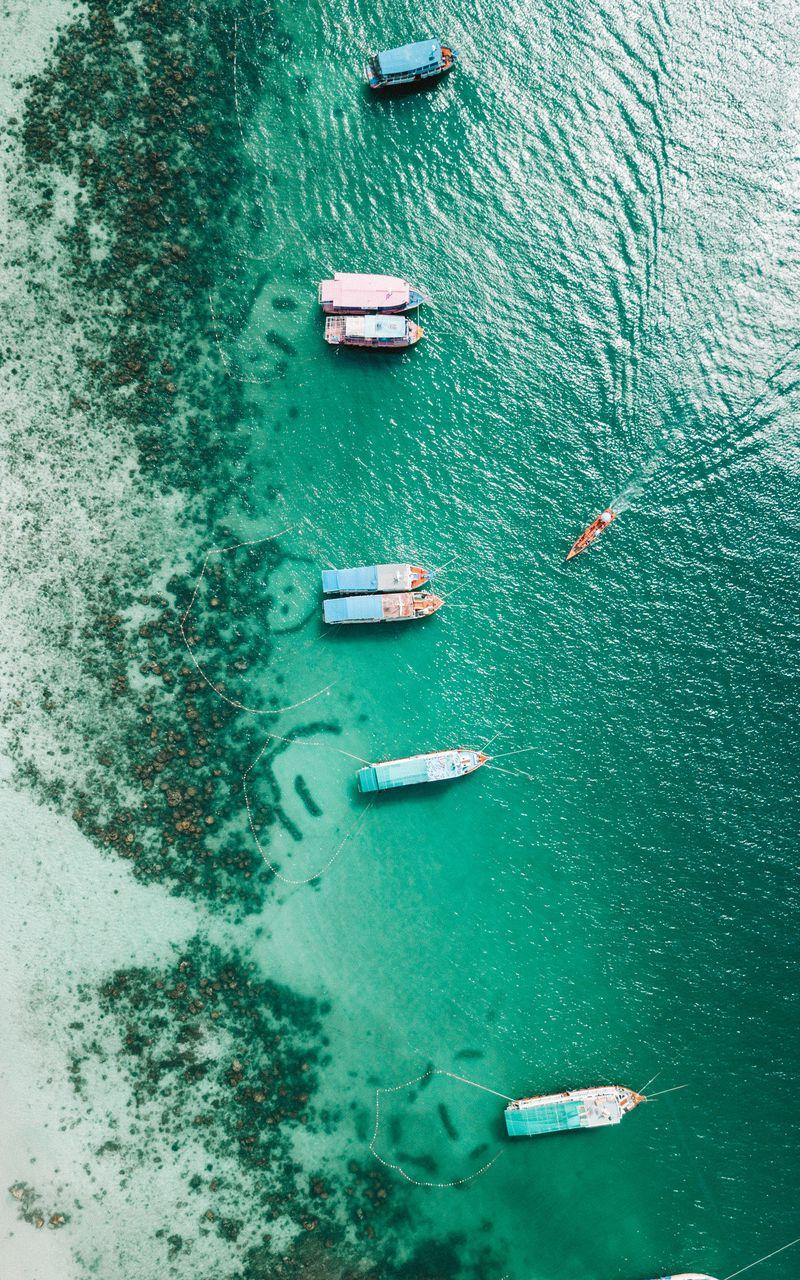 800x1280 Wallpaper shore, boats, sandbar, ocean, moored, aerial view