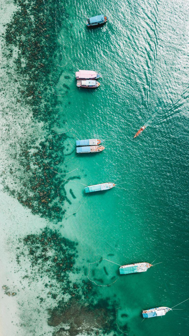800x1420 Wallpaper shore, boats, sandbar, ocean, moored, aerial view