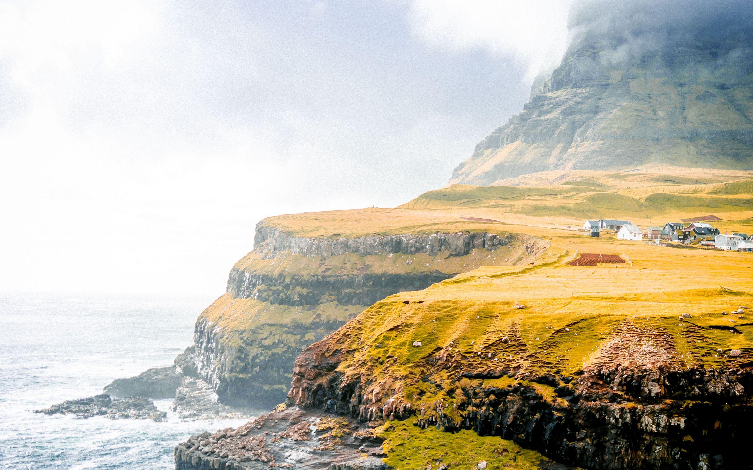 2560x1600 Wallpaper shore, cliff, plain, sea, village, home, greens