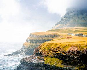Preview wallpaper shore, cliff, plain, sea, village, home, greens