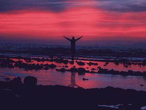 Preview wallpaper shore, guy, jump, stones, sunset