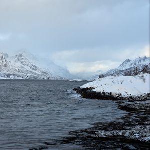 Preview wallpaper shore, mountains, snow, water, landscape