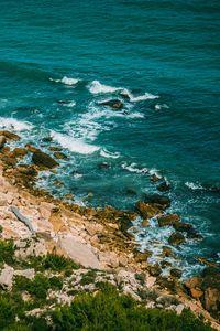 Preview wallpaper shore, sea, stones, waves, surf, vegetation