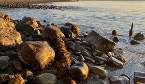 Preview wallpaper shore, stones, sea, horizon, landscape