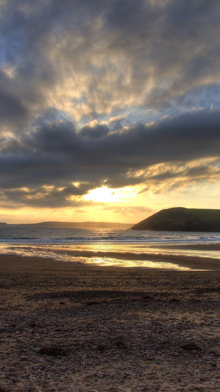 720x1280 Wallpaper shore, water, sunset, landscape