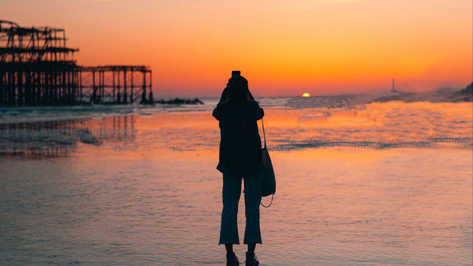 1920x1080 Wallpaper silhouette, alone, beach, sea, sunset, dark