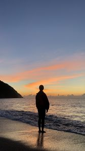 Preview wallpaper silhouette, alone, sea, beach, sunset, dark
