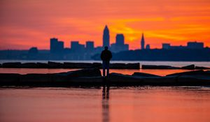 Preview wallpaper silhouette, alone, water, sunset, dark