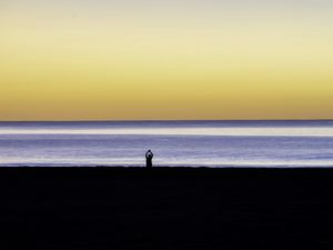 Preview wallpaper silhouette, loneliness, alone, beach, sunset, sea